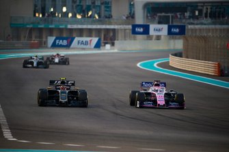 Sergio Perez, Racing Point RP19, battles with Kevin Magnussen, Haas F1 Team VF-19