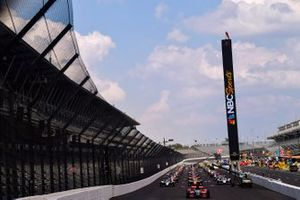 The field waits on the racetrack before the Indy 500 begins.