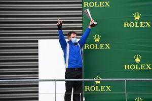 The Carlin podium representative with the teams trophy