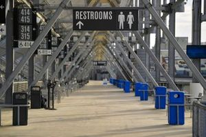 The restrooms signs at an empty Daytona International Speedway corridor