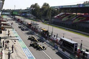 Daniel Ricciardo, Renault F1 Team R.S.20, and Esteban Ocon, Renault F1 Team R.S.20, leave the pits