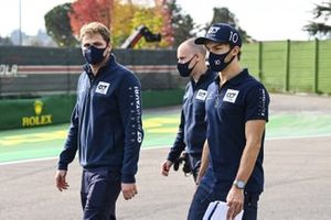 Pierre Gasly, AlphaTauri, walks the track with his team
