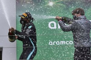 Lewis Hamilton, Mercedes-AMG F1, 1st position, and Steven Lord, Mercedes, spray Champagne on the podium