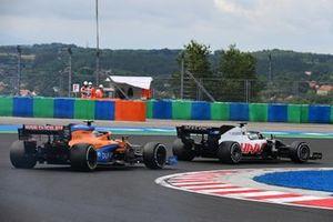 Romain Grosjean, Haas VF-20, leads Lando Norris, McLaren MCL35