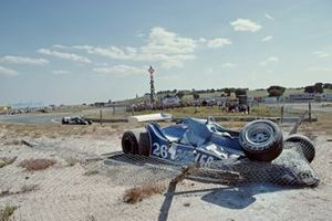 The Ligier JS11/15 Ford of Jacques Laffite is wrapped up in the catch fencing after crashing out of the race