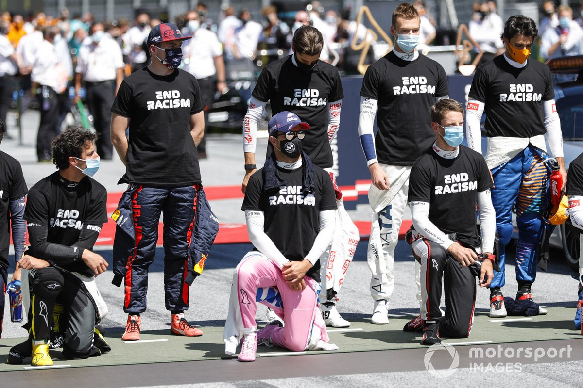 Daniel Ricciardo, Renault F1, Max Verstappen, Red Bull Racing, Sergio Perez, Racing Point, Daniil Kvyat, AlphaTauri, and Romain Grosjean, Haas F1, on the grid in support of the End Racism campaign
