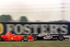 Michael Schumacher, Ferrari F300, Mika Hakkinen, McLaren MP4/13 Mercedes-Benz