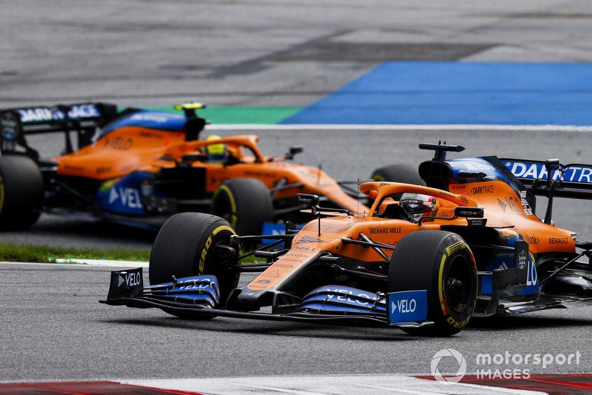 Carlos Sainz Jr., McLaren MCL35, leads Lando Norris, McLaren MCL35