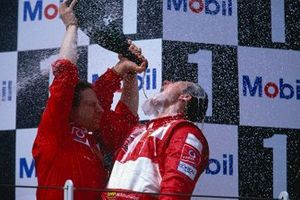 Michael Schumacher, Ferrari celebrates with team boss Jean Todt