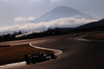 Track action with Mount Fuji in the background