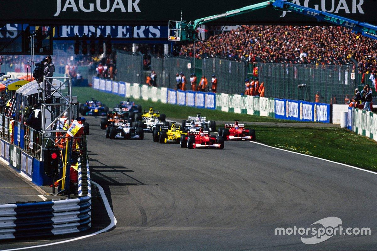 Michael Schumacher, Ferrari F1-2000, Rubens Barrichello, Ferrari F1-2000 in testa alla partenza della gara, GP della Gran Bretagna del 2000
