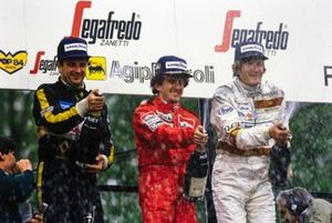 Podium: Second placed Elio De Angelis, Lotus, race winner Alain Prost, McLaren, third placed Thierry Boutsen, Arrows