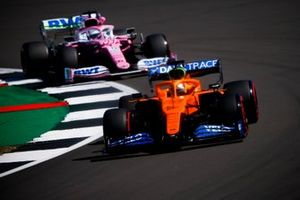 Carlos Sainz Jr., McLaren MCL35 and Nico Hulkenberg, Racing Point RP20