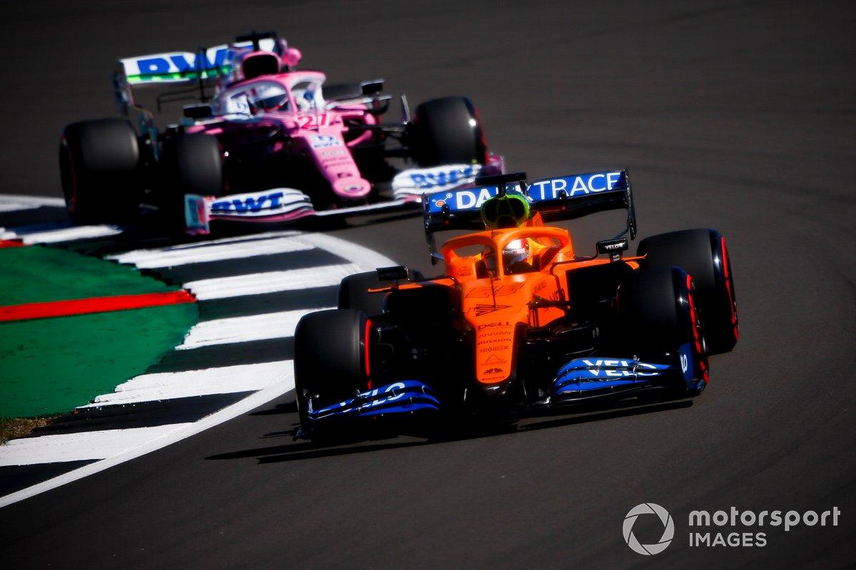 Carlos Sainz Jr., McLaren MCL35 y Nico Hulkenberg, Racing Point RP20