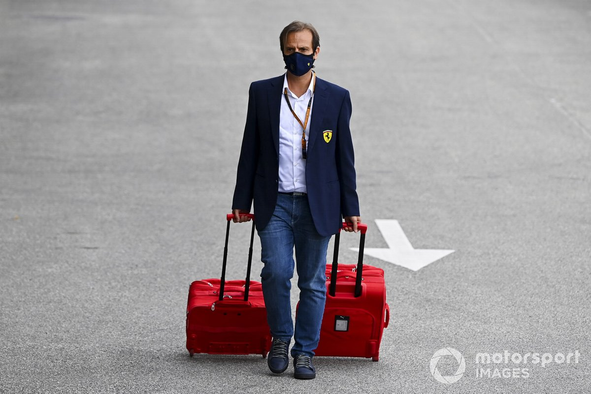 A Ferrari team member arrives at the circuit