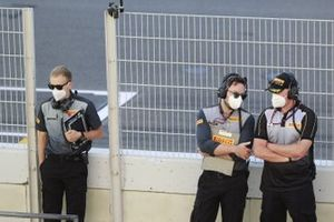 Pirelli personnel on the pit wall