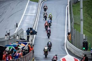 MotoGP riders exit the pit lane