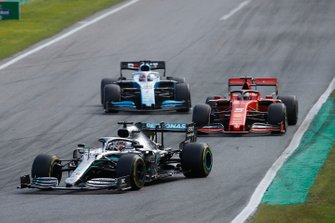 Lewis Hamilton, Mercedes AMG F1 W10, leads Sebastian Vettel, Ferrari SF90, and George Russell, Williams Racing FW42