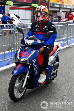 Pierre Gasly, Toro Rosso, rides a scooter