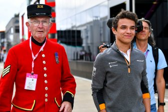 Lando Norris, McLaren in the paddock with a Chelsea Pensioner