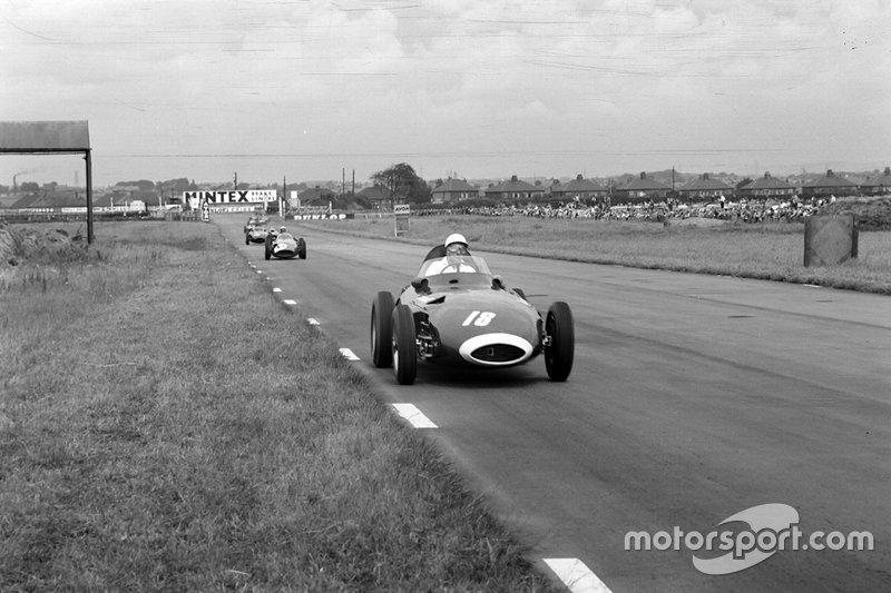 Stirling Moss, Vanwall; Tony Brooks, Vanwall and Jean Behra, Maserati