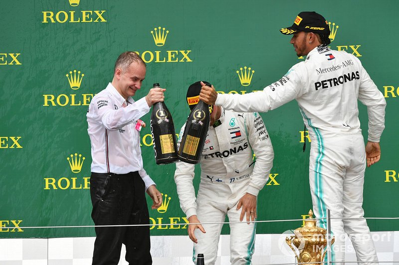 Valtteri Bottas, Mercedes AMG F1, 2nd position, and Lewis Hamilton, Mercedes AMG F1, 1st position, celebrate on the podium with their team mate