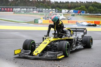 Daniel Ricciardo, Renault F1 Team, climbs out of his car and retires from the race
