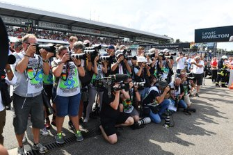 Photographers gather for a shot of Lewis Hamilton, Mercedes AMG F1