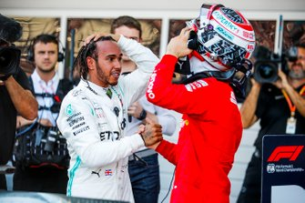 Lewis Hamilton, Mercedes AMG F1, 1st position, and Charles Leclerc, Ferrari, 3rd position, congratulate each other in Parc Ferme