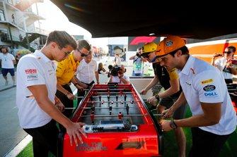 Lando Norris, McLaren, Carlos Sainz Jr., McLaren and Nico Hulkenberg, Renault F1 Team play table football in the paddock