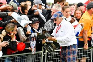 Sir Jackie Stewart, 3-time F1 Champion, signs autographs for fans
