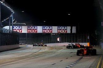 Charles Leclerc, Ferrari SF90, leads Lewis Hamilton, Mercedes AMG F1 W10, Sebastian Vettel, Ferrari SF90, Max Verstappen, Red Bull Racing RB15, and Valtteri Bottas, Mercedes AMG W10