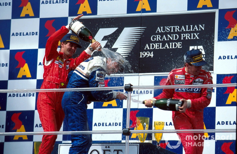 Podium: second place Gerhard Berger, Ferrari, Race winner Nigel Mansell, Williams and third place Martin Brundle, McLaren