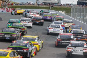 Kyle Busch, Joe Gibbs Racing, Toyota Camry M&M's leads the field into Turn 2