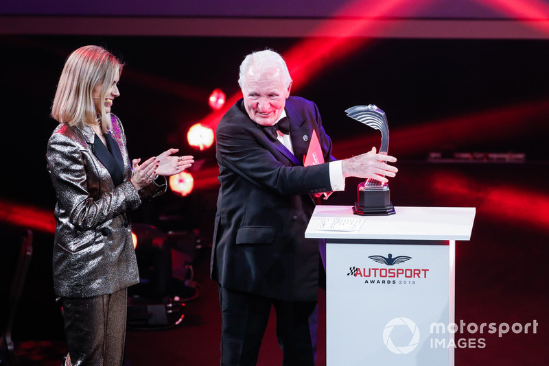 Nicki Shields with Paddy Hopkirk on stage to present the Rally Car of the Year award