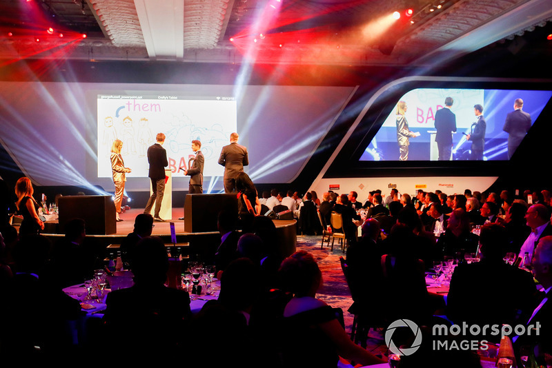 Williams F1 Driver George Russell, and McLaren F1 driver Lando Norris on stage with hosts Nicki Shields and David Croft