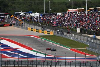 Kimi Raikkonen, Ferrari SF71H leads Lewis Hamilton, Mercedes-AMG F1 W09