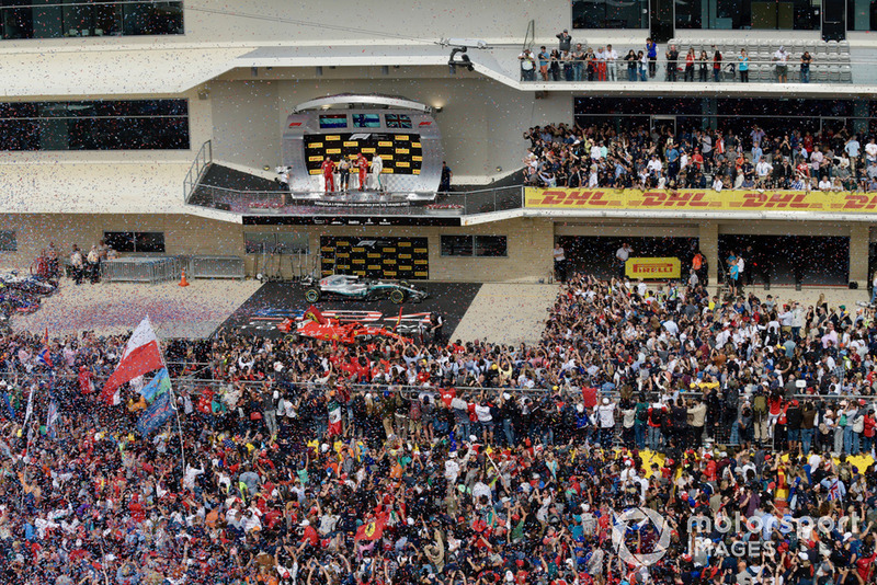 Fans on the track with Max Verstappen, Red Bull Racing, Carlo Santi, Ferrari Race Engineer, Kimi Raikkonen, Ferrari and Lewis Hamilton, Mercedes AMG F1 on the podium