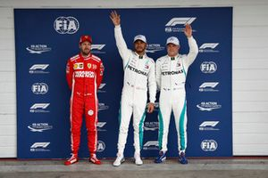 Top three Qualifiers, second placed Sebastian Vettel, Ferrari, pole man Lewis Hamilton, Mercedes AMG F1, and Valtteri Bottas, Mercedes AMG F1