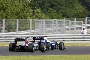 Michael Schumacher, Mercedes GP MGP W01 and Rubens Barrichello, Williams FW32