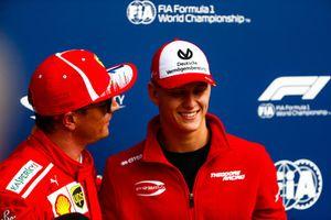 Mick Schumacher presents Kimi Raikkonen, Ferrari, with the Pirelli Pole Position award