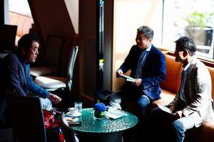 VIPs enjoy coffee in a lounge