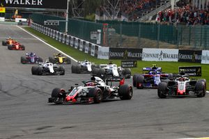 Romain Grosjean, Haas F1 Team VF-18, leads Kevin Magnussen, Haas F1 Team VF-18, Pierre Gasly, Toro Rosso STR13, Marcus Ericsson, Sauber C37, and Sergey Sirotkin, Williams FW41