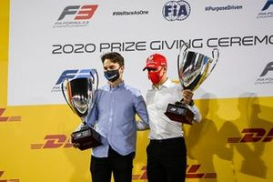 F3 Championship 1st position Oscar Piastri, Prema Racing and F2 Championship 1st postion Mick Schumacher, Prema Racing celebrate on the podium with the trophy