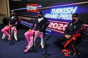 Sergio Perez, Racing Point, pole man Lance Stroll, Racing Point, and Max Verstappen, Red Bull Racing, in the post Qualifying Press Conference