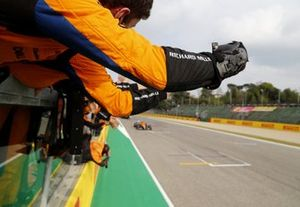 Lando Norris, McLaren MCL35M, 3rd position, is cheered over the line by his team