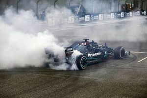 Lewis Hamilton, Mercedes F1 W11, 3rd position, performs some celebratory donuts at the end of the race
