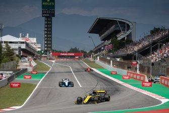 Daniel Ricciardo, Renault R.S.19, leads George Russell, Williams Racing FW42, and Sebastian Vettel, Ferrari SF90