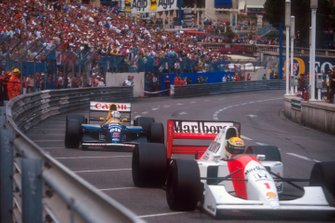 Ayrton Senna, McLaren MP4/7A Honda, 1st position with Nigel Mansell, Williams FW14B Renault, 2nd position close behind, trying to pass in the last few laps of the race