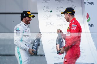 Lewis Hamilton, Mercedes AMG F1, 2nd position, and Sebastian Vettel, Ferrari, 3rd position, on the podium